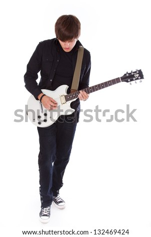 Full lenght image of teeange boy who is playing on electric guitar - stock photo