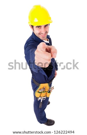 Full lenght of a smiling young builder pointing, isolated on white