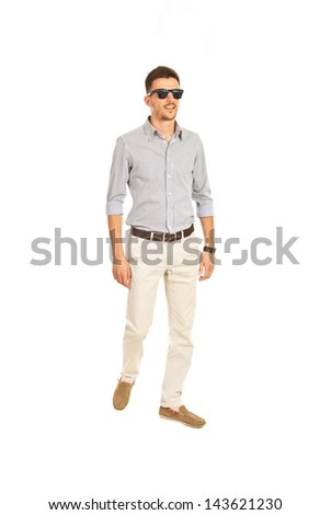 Full lenght of modern business man with sunglasses walking isolated on white backgorund - stock photo