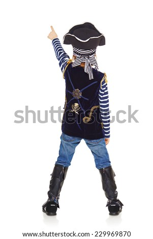 Full length back view of little boy wearing pirate costume standing over white background and pointing upwards. - stock photo