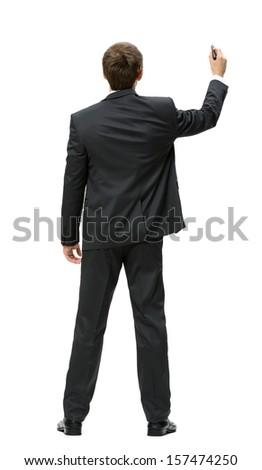 Full-length backview of businessman writing with marker on imaginary screen, isolated on white. Concept of leadership and success - stock photo