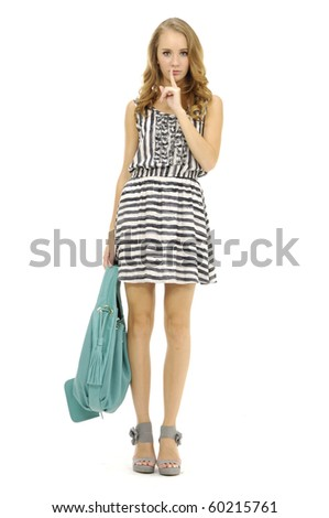 Full length beautiful fashion woman with bag posing in the studio