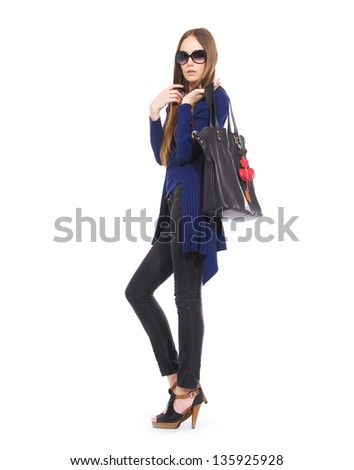 full length beautiful fashionable woman in blue coat with handbag posing - stock photo