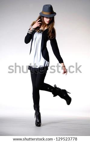 Full length Beautiful slim woman in sunglasses posing - stock photo