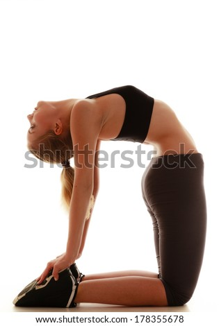 Full length beautiful sporty woman doing stretching exercise camel pose studio shot isolated on white background