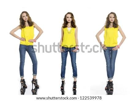 Full length beautiful stylish three girl in jeans posing at studio - stock photo