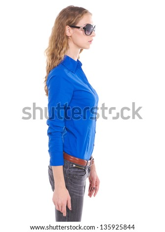 Full length beautiful woman in sunglasses posing