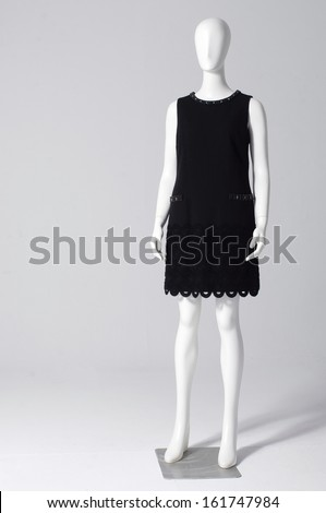 full length black dress mannequin isolated on gray background - stock photo