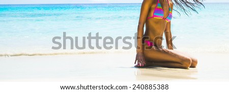 Full length body young adult erotic girl on tropical beach with white hot wet sand Cute woman sit in waves warm water texture ocean or sea Female wearing colorful pink swimsuit against yacht - stock photo