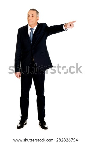 Full length boss dismissing someone. - stock photo