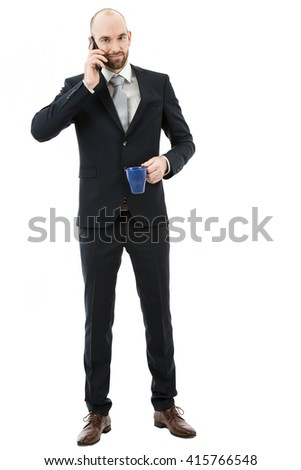 Full length business man talking on the phone - stock photo