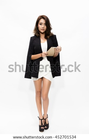 full length business woman using touch pad tablet pc isolated on white background, model is a asian beautiful - stock photo