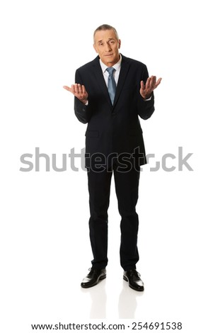Full length businessman making undecided gesture. - stock photo