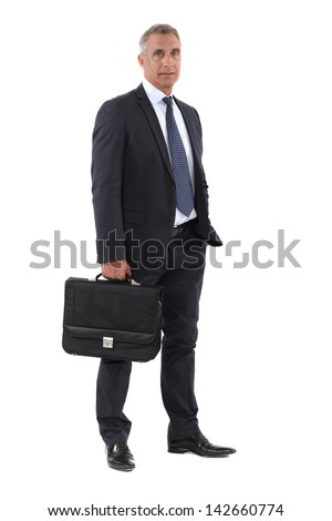 Full length businessman with a briefcase - stock photo