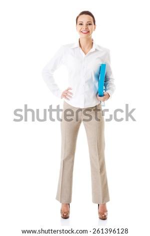 Full length businesswoman holding binder. - stock photo