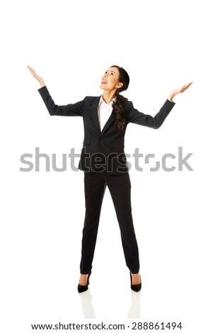 Full length businesswoman holding copyspace. - stock photo