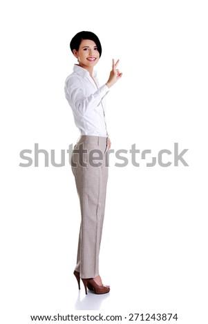 Full length businesswoman showing OK sign. - stock photo