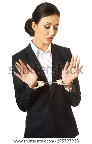 Full length businesswoman with handcuffs. - stock photo