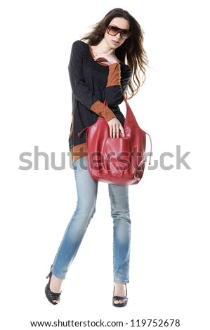 Full length casual fashion women in jeans wearing sunglasses posing shot in studio - stock photo