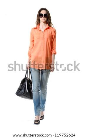 Full length casual fashion women wearing sunglasses walking - stock photo