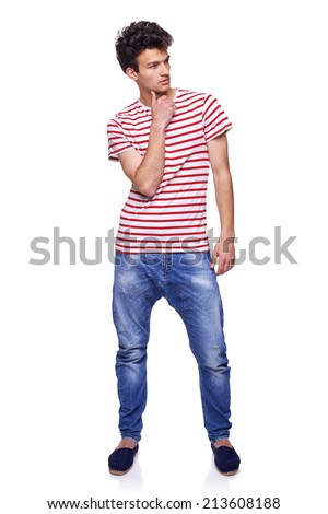 Full length casual trendy man thinking with hand on chin looking away to the side, over white background - stock photo