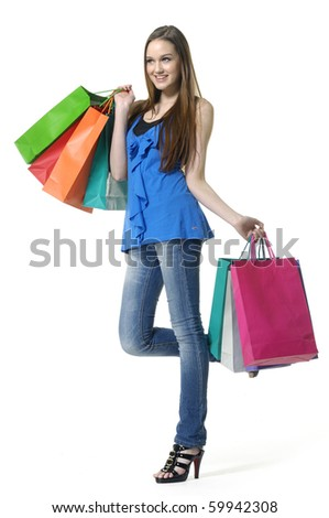 Full length casual woman with shopping bag - stock photo