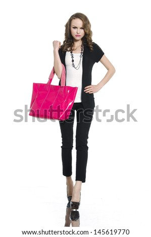 Full length casual young fashion holding red bag walking - stock photo