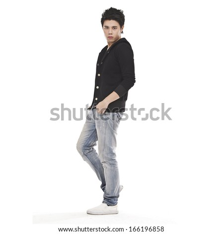 Full length casual young man in jeans standing on white