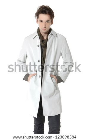 Full length Casual young man standing - isolated over a white background