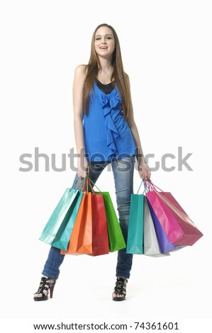 Full length casual young woman with shopping bag - stock photo