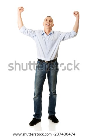 Full length cheerful man with hands up. - stock photo