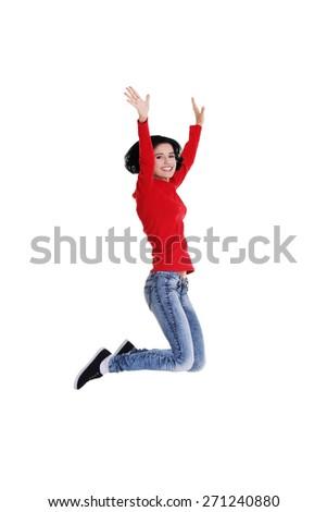 Full length cheerful woman jumping. - stock photo