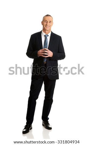 Full length confident businessman with clenched hands. - stock photo