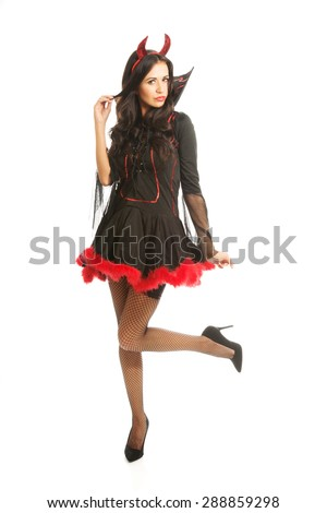 Full length devil woman standing with bended knee. - stock photo