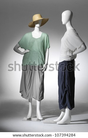 full-length fashion clothes on two female mannequin in light background - stock photo