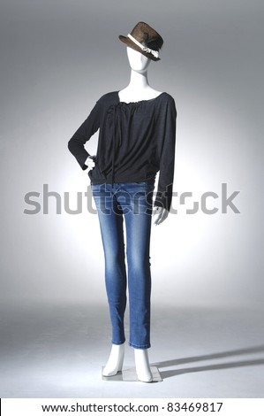 full-length Fashion clothing in blue jeans mannequin in light background - stock photo