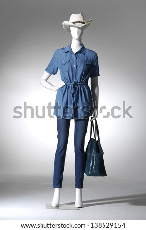 full-length Fashion female in hat on mannequin in light background - stock photo