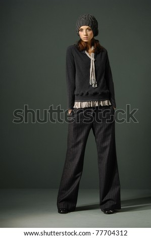 full-length Fashion model in fashion dress in dark studio - stock photo