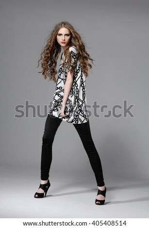Full length fashion or casual girl posing on light background - stock photo
