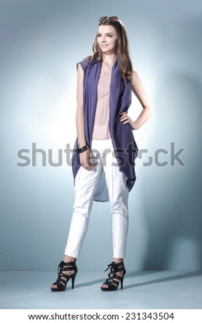 Full length fashion or casual girl posing on light background/ Studio shot - stock photo