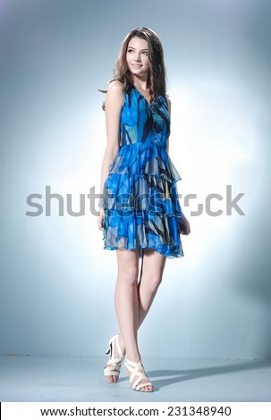 Full length fashion or casual girl posing on light background/ walking in studio - stock photo
