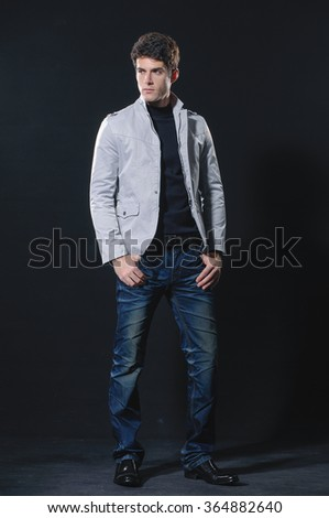full length fashion Shot of a young man a professional model  - stock photo