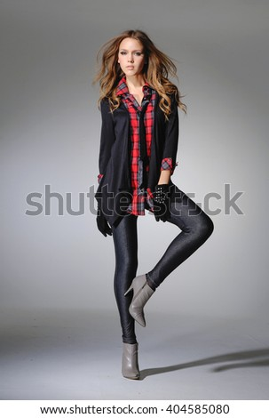 Full length fashionable girl posing in the studio
