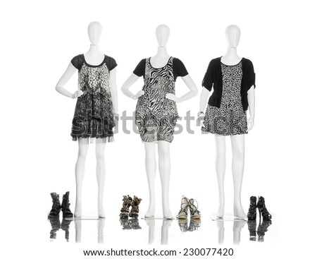 full-length female clothing with boots on three mannequin  - stock photo
