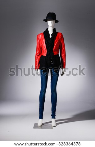 full-length female in jeans with hat on mannequin in light background - stock photo