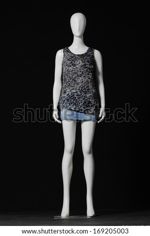 full-length female mannequin dress and shorts on black background