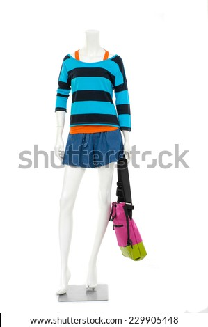 Full length female mannequin striped shirt dressed in jeans pants with bag   - stock photo