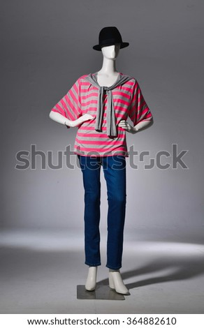 full-length female with in cap on mannequin in light background - stock photo