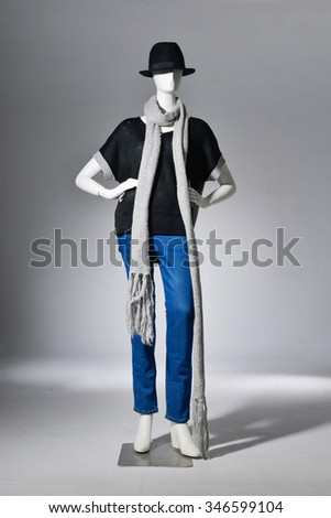 full-length female with scarf in hat on mannequin -light background - stock photo