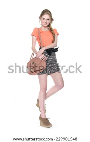 Full length female young model wearing short white pants and shirt with blue hat on white background - stock photo